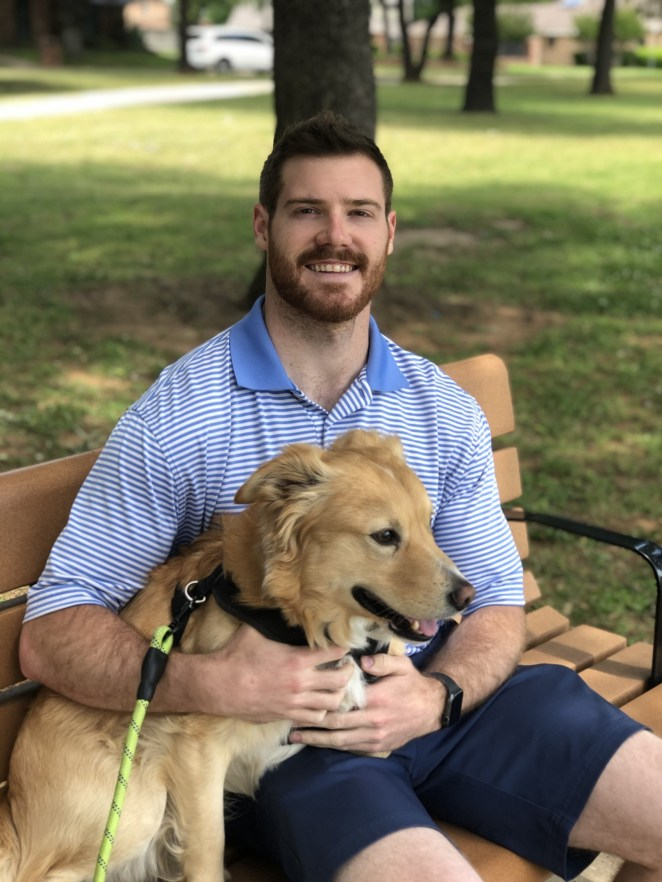 Photo of Dr. Hunter with his dog.