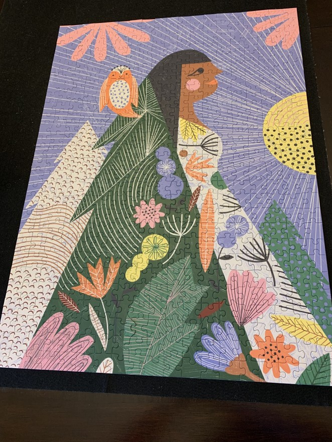 the forest walk puzzle featuring a woman walking through an array of flowers