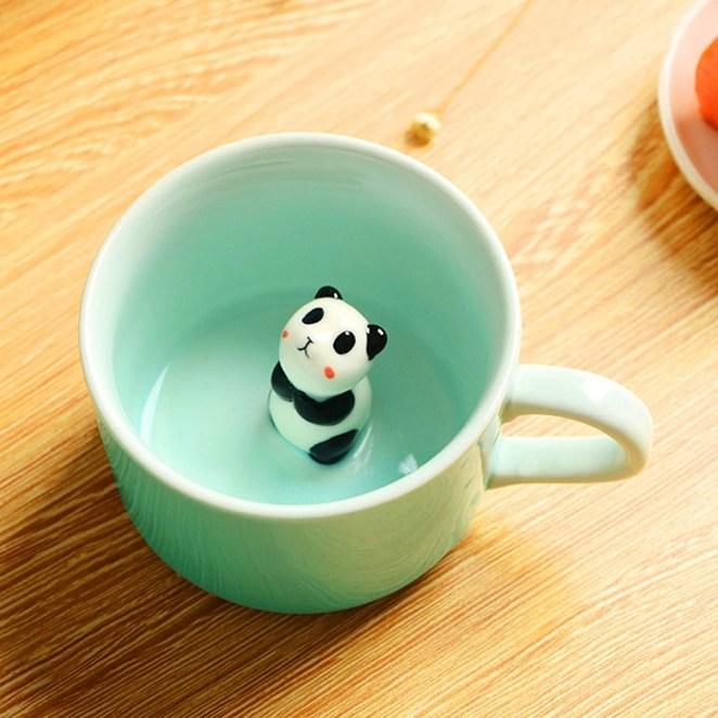 The small mint mug with a panda figure on the base