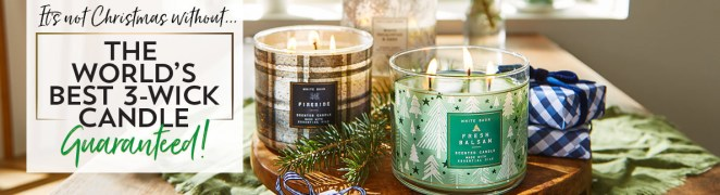 two three-wick festive candles