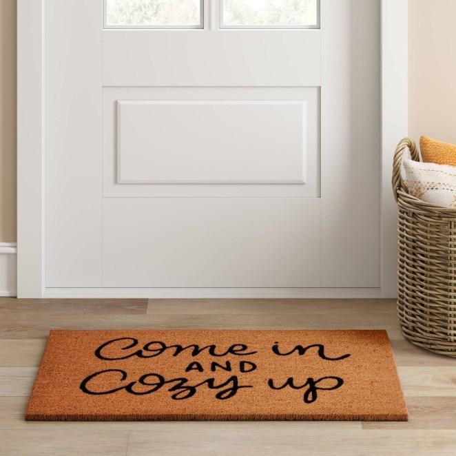 """A home with a doormat that says """"come in and cozy up"""""""