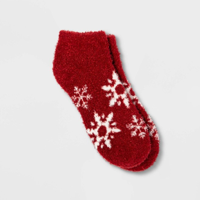 A pair of red ankle socks with snowflakes on them.