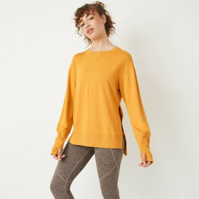 A model wearing a yellow pullover