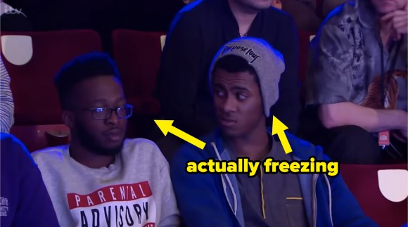 """two audience members with an arrow pointing to them that says, """"actually freezing"""""""