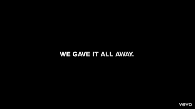 """Still from the video that says """"We gave it all away"""""""
