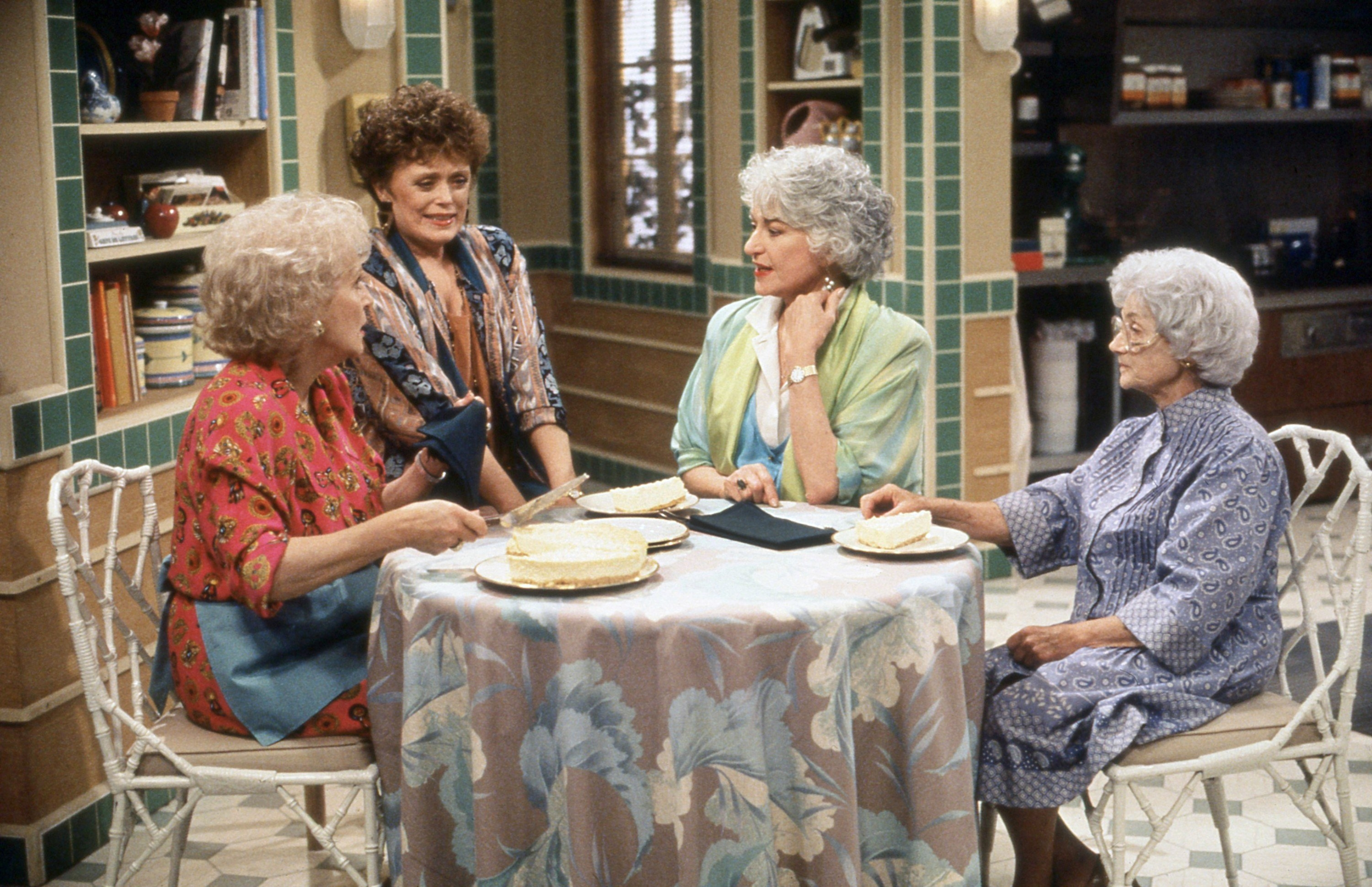 the Golden Girls at a table
