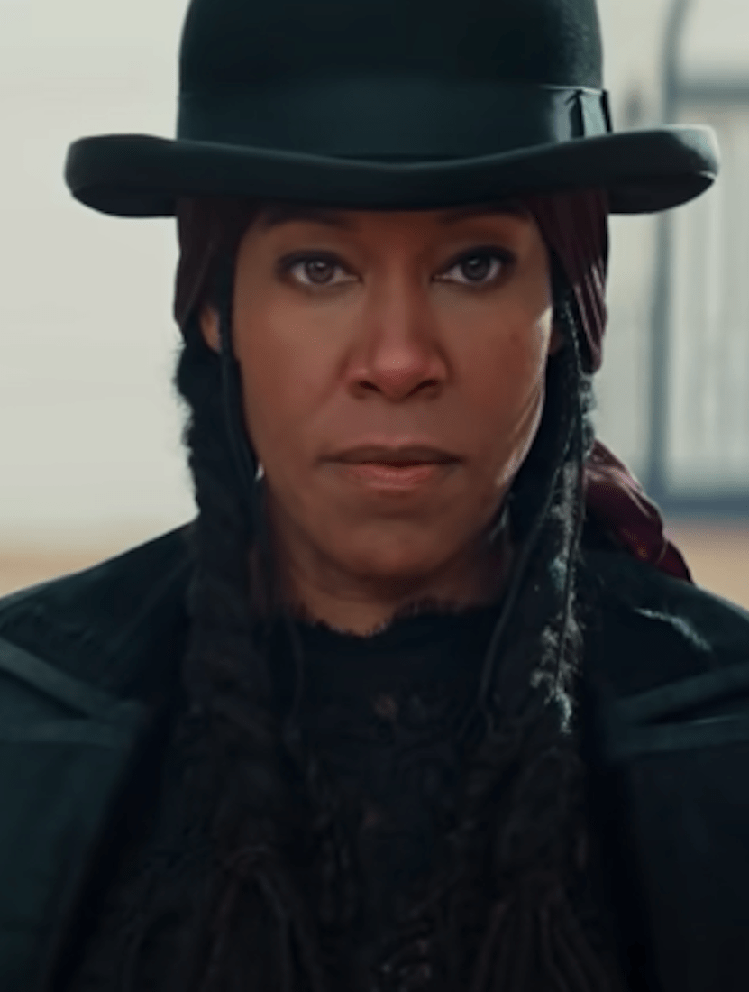 Regina King as a cowgirl with a serious demeanor on her face