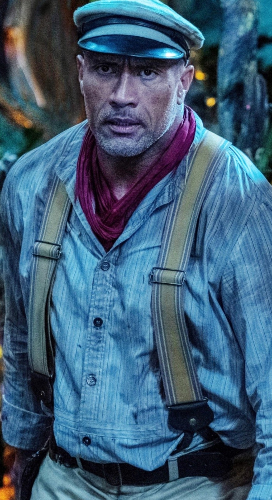 """Dwayne """"The Rock"""" Johnson wearing a cap, suspenders, and a button-up shirt"""