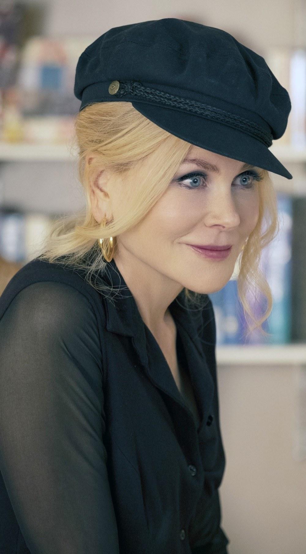 Nicole Kidman wearing a short black hat with a black blouse
