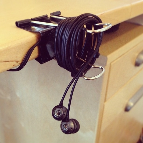 Use a binder clip to keep your earbuds neat at your desk.