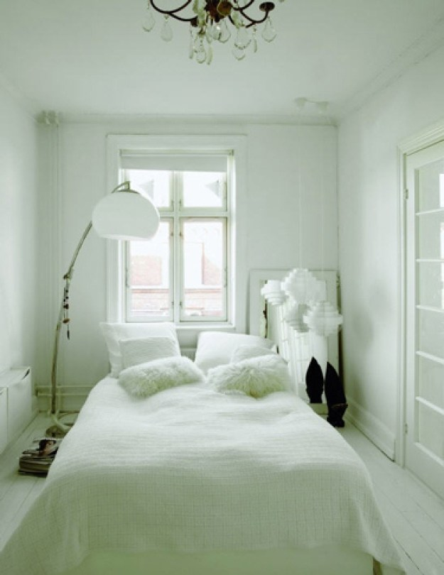 You can skip the headboard in favor of a few inches of more floorspace.