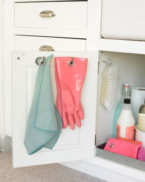 The insides of cabinets are also great places to put hooks for rags, gloves, and pot holders.