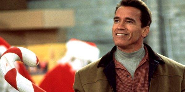 Arnold Schwarzenegger with a candy cane