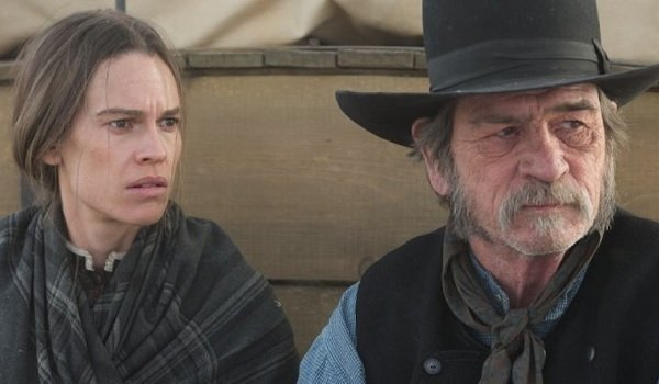 The Homesman Hilary Swank Tommy Lee Jones looking off into the Prairie