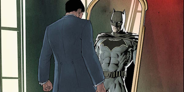 Bruce Wayne looking into mirror seeing Batman