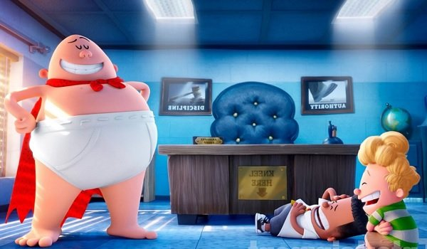 Captain Underpants strikes a heroic pose in the principal's office