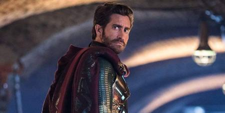 Image description: Mysterio looks over his shoulder in front of a blurred urban background.