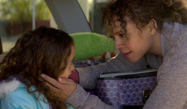 Rattlesnake Carmen Ejogo holds her daughter's face in her hand