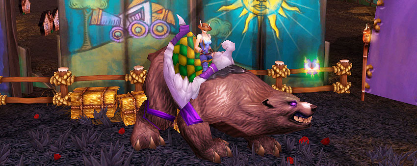 Female Blood Elf riding a Darkmoon Dancing Bear
