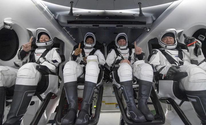 NASA astronauts Shannon Walker, left, Victor Glover, Mike Hopkins, and Japan Aerospace Exploration Agency (JAXA) astronaut Soichi Noguchi, right are seen inside the SpaceX Crew Dragon Resilience spacecraft onboard the SpaceX GO Navigator recovery ship shortly after landing in the Gulf of Mexico off the coast of Panama City, Florida, at 2:56 a.m. EDT May 2, 2021.