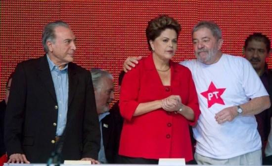 O vice-presidente Michel Temer (PMDB), a presidente Dilma (PT) e Lula (PT), em 2014