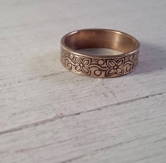 Copper Ring with a beautiful flower pattern engraved on to a thick ring band.