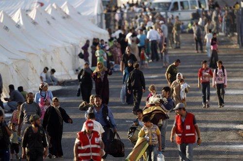 Refugiados De Siria Huyen A Turquía