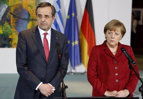 Antonis Samaras y Angela Merkel