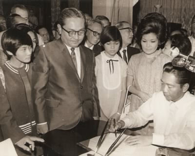 Ramon C. Fernandez was appointed by President Ferdinand Marcos as an Associate Justice of the Supreme Court Justice on 27 May 1977.  Also in the photo are his wife, Lydia and daughters Lydia and Cynthia.