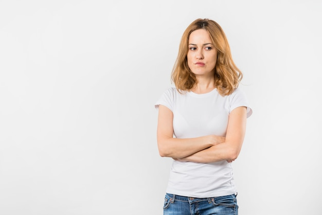 Image result for picture of a woman look frustrated with arms folded