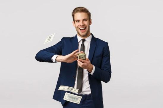 Cool man throws up dollars | Free Photo