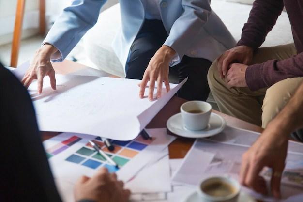 Interior designer presenting blueprint