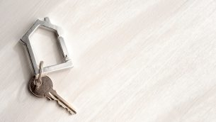 Top view house keys on copy space background