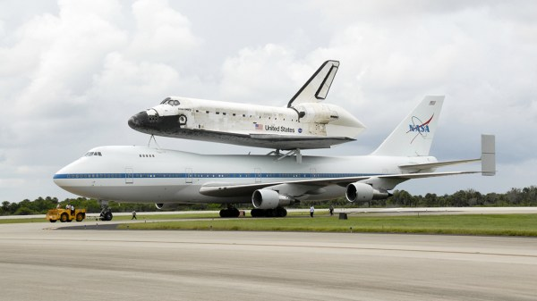 Space Shuttle Discovery Flies To Its Retirement Home