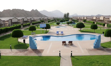 Ajman: 1  or 2 Night Stay in One  or Two Bedroom Chalets with Half or Full Board at Holiday Arabian Resort