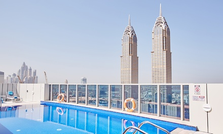 Dubai: 1 Night for 2 Adults and 1 Child at 4* DusitD2 Kenz Hotel with Dubai Parks Theme Park Tickets