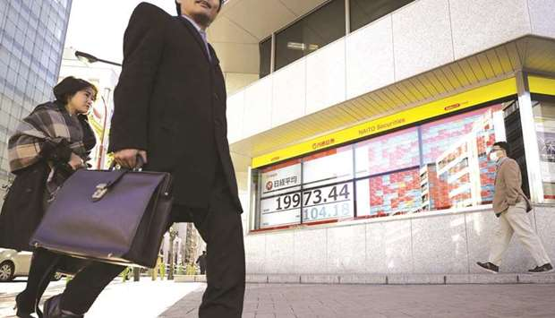 Asian markets mostly up after Wall Street rally