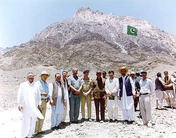 Abdul Qadeer Khan (fifth from left) standing with other military and scientific officials outside the iron-steel tunnel inside the Räs Koh Hills in 1998 just before Pakistan carried out its first public nuclear weapons test there