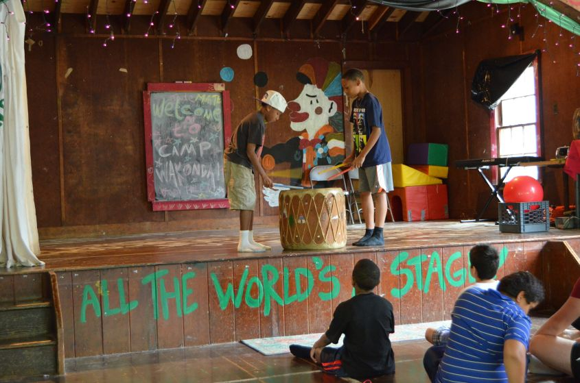 Campers show off their drumming skills.