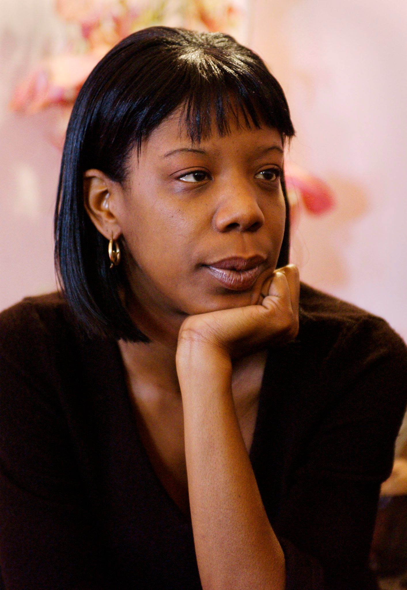 """<span class='image-component__caption' itemprop=""""caption"""">Marcy Borders, survivor of the 11 September 2001 attack on the World Trade Center, is seen during an interview in her apartment, 08 March, 2002, in Bayonne, New Jersey.</span>"""