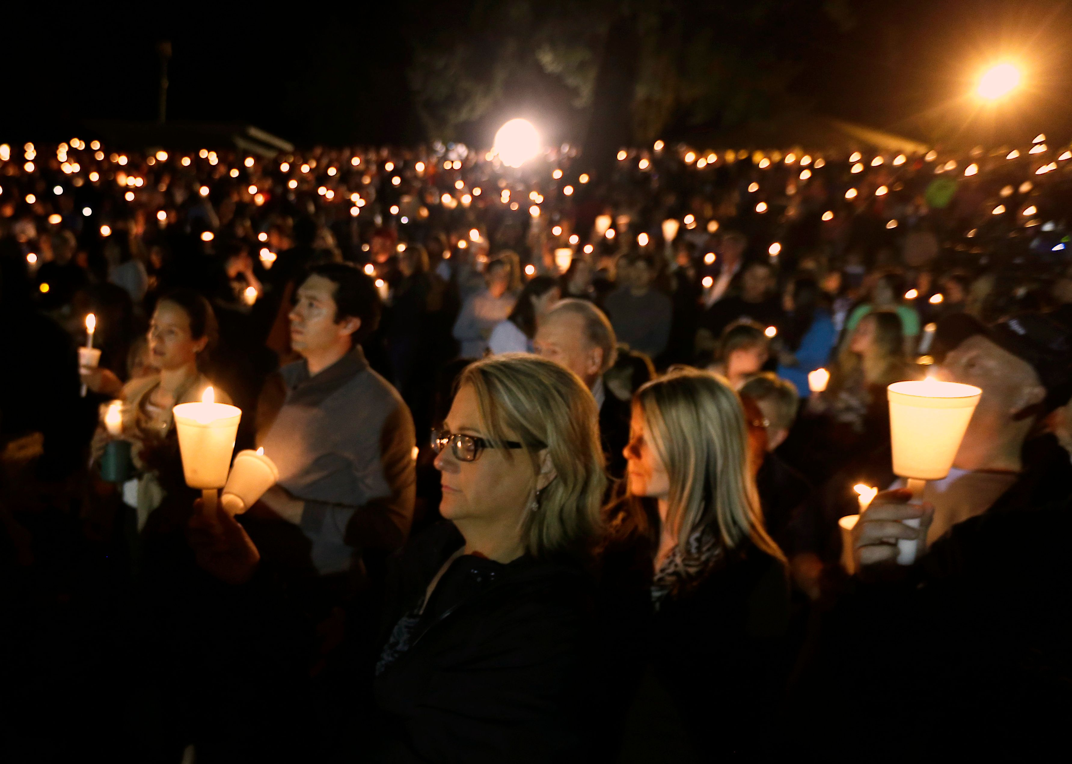 "<span class='image-component__caption' itemprop=""caption"">Community members gather for a vigil for those killed in a shooting at Umpqua Community College in Roseburg, Oregon on Oct. 1, 2015.</span>"