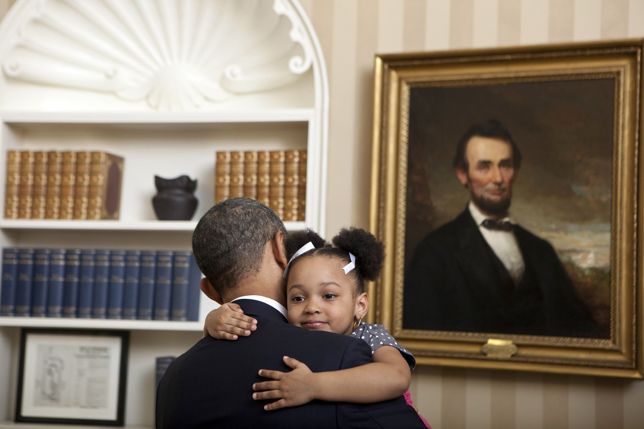 "Feb. 1, 2012 ""Lawrence Jackson captured this cute photograph of the President holding Arianna Holmes, 3, before taking a departure photo with members of her family in the Oval Office."" (Official White House Photo by Lawrence Jackson)"