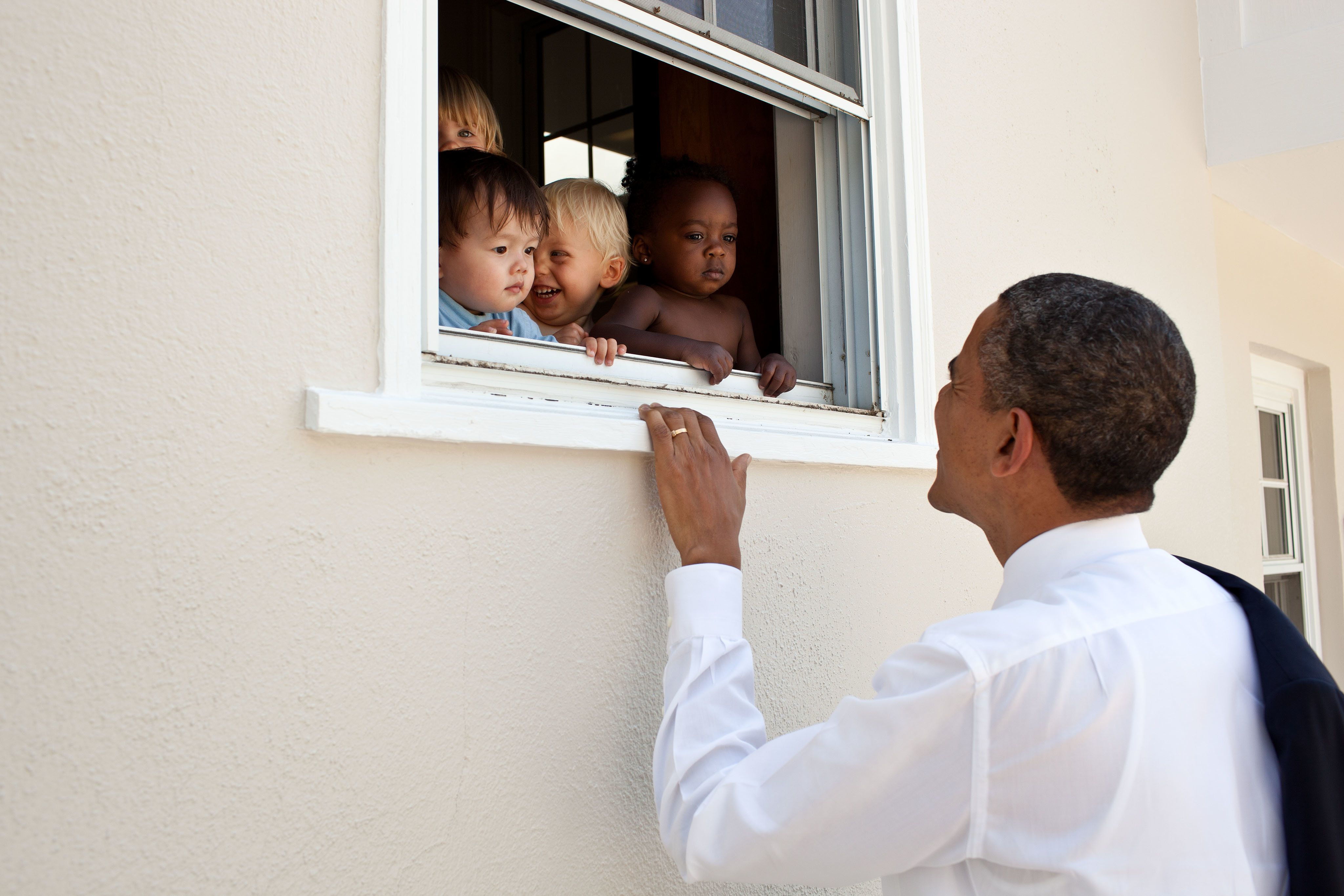 President Barack Obama greets children at a day care facility adjacent to daughter Sasha's school in Bethesda, Md., following her 4th grade closing ceremony, June 9, 2011. (Official White House Photo by Pete Souza)