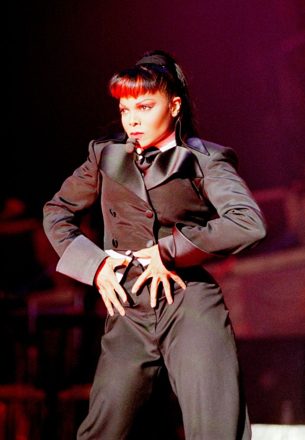Performing onstage during The Velvet Rope tour.