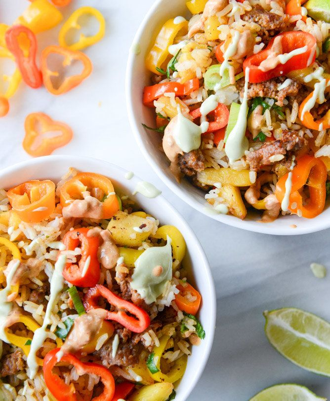 "<strong>Get the <a href=""http://www.howsweeteats.com/2015/08/pineapple-chorizo-rice-bowls-with-avocado-and-chipotle-cream/"" t"