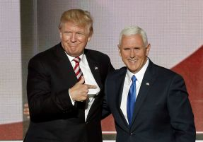 Republican U.S. presidential nominee Donald Trump (L) greets vice presidential nominee Mike Pence after Pence spoke at the Re