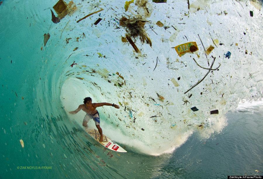 "In 2012,&nbsp;photographer Zak Noyle captured the Indonesian surfer Dede Surinaya surfing in waters <a href=""https://www.huff"