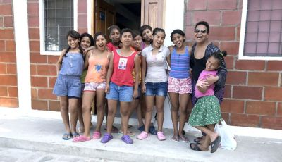 Cynthia with teen girls at orphanage