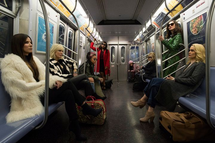 The cast on a subway train.