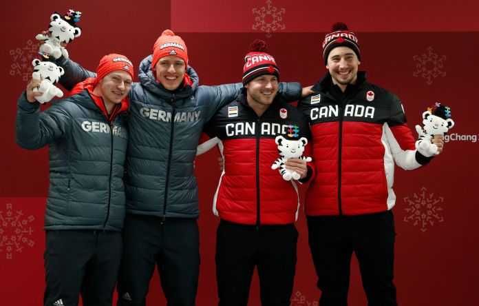 Germany And Canada Tie For Gold In Two-Man Bobsled Race Germany And Canada Tie For Gold In Two-Man Bobsled Race 5a8ae9a92000002d00eaf4b3